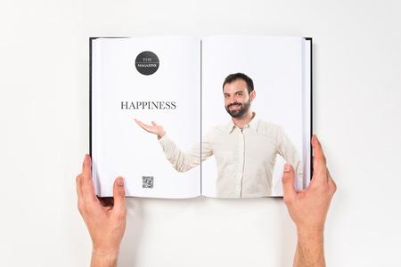 Man showing something printed on book photo