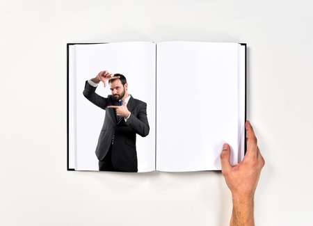 Young businessman doing a frame sign printed on book photo