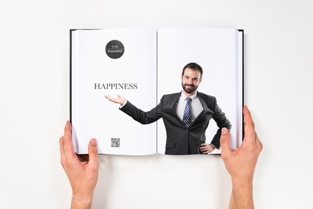 Businessman making showing printed on book photo
