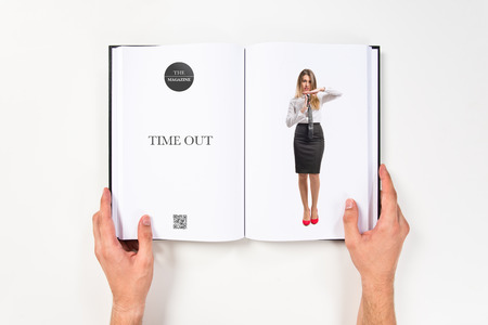 Young girl making time out gesture printed on book photo