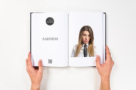 boring frame: Sad young girl printed on book Stock Photo
