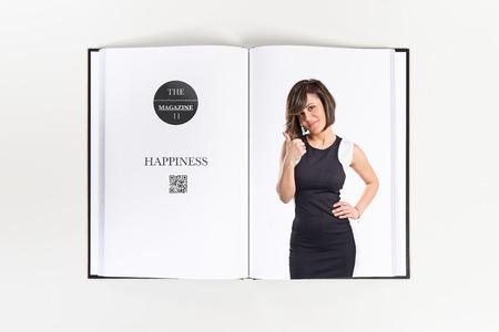 Pretty woman making Ok sign printed on book photo