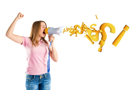 Blonde girl shouting with a megaphone over white background  photo