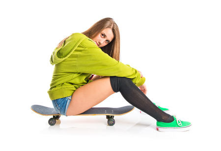 Skater with green sweatshirt over white background photo