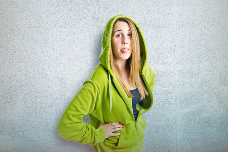 Young girl doing a joke over textured background  photo