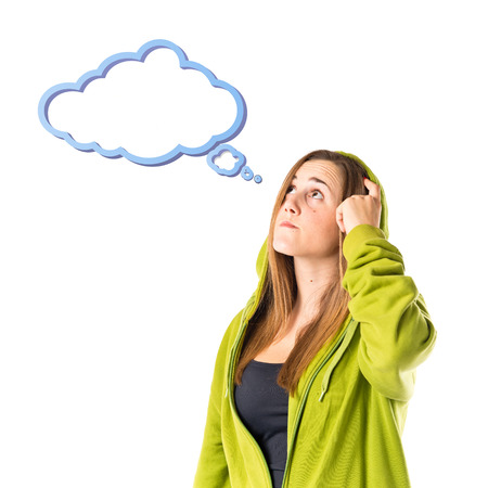 Young girl thinking over isolated white background  photo