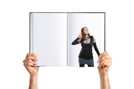 Woman in black clothes listening printed on book photo