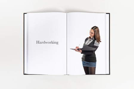 Young student writing printed on book photo