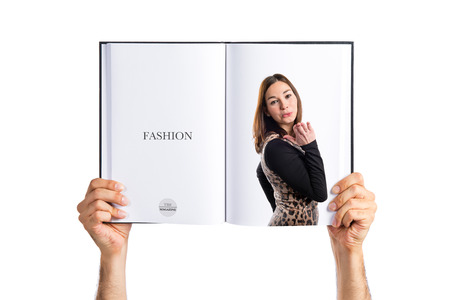 Pretty brunette asian girl printed on book photo