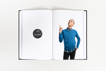 man pointing up: Young man pointing up printed on book