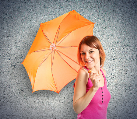 Girl holding an umbrella over textured background  photo