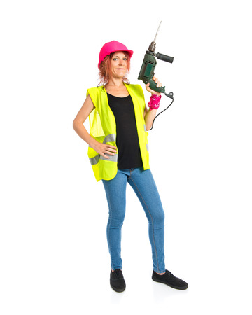 Worker woman with drill over white background photo