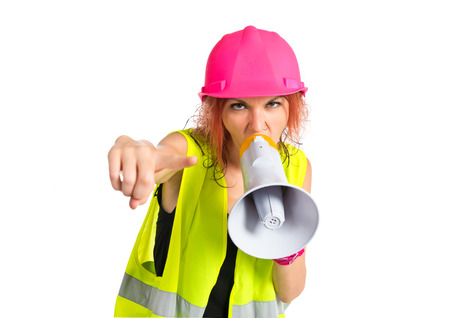 Worker woman shouting over isolated white background photo