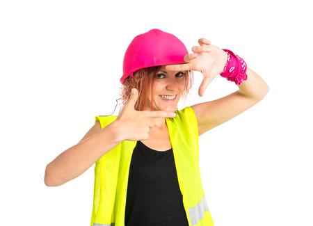 mujer trabajadora: Mujer del trabajador de enfoque con los dedos sobre un fondo blanco Foto de archivo