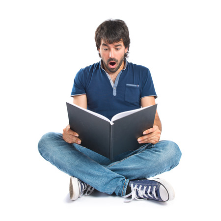 Man reading a book over white background photo