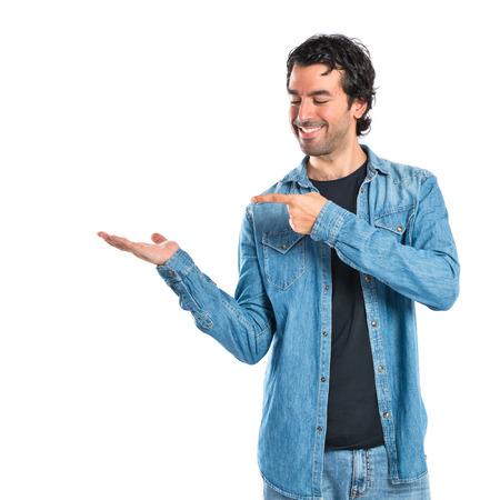 Man holding something over white background photo