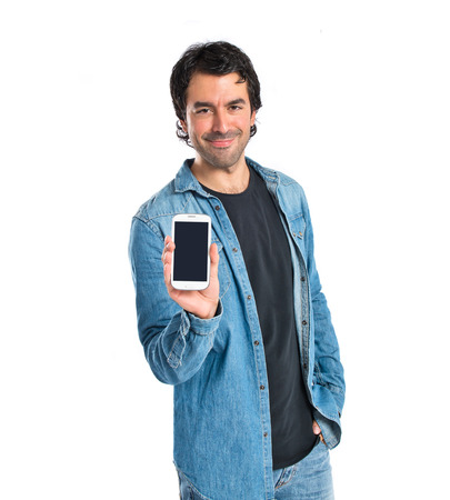 Man showing his mobile over white background photo