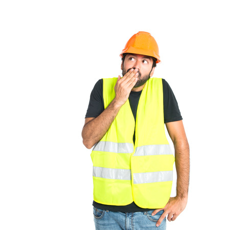 Workman doing surprise gesture over white background