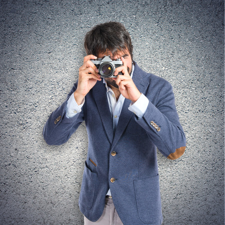 Man photographing over textured background photo