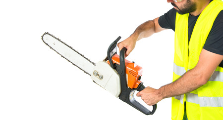 Workman with chainsaw over white background photo