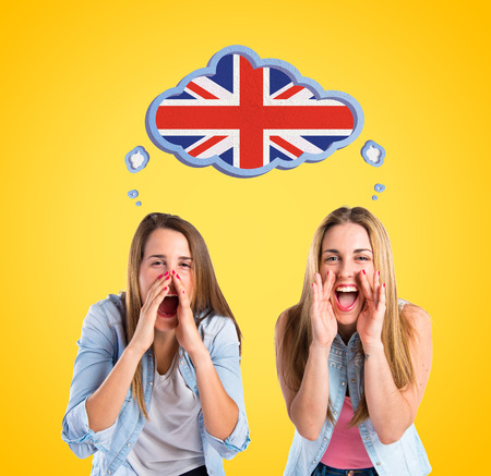 Friends shouting over yellow background photo