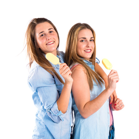 Friends eating ice cream over white background photo