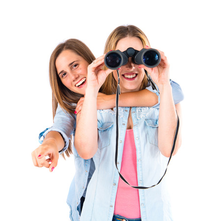 Friends with binoculars over isolated white background photo