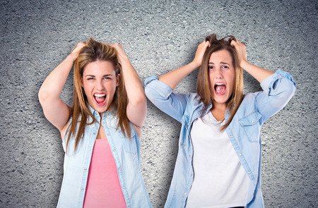 frustrated girls over textured background Stock Photo