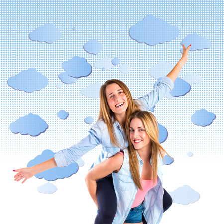 Friends playing over white background photo