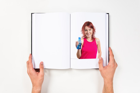 Young sport girl with water printed on book photo