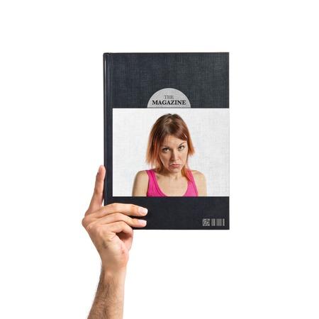 Sad young girl printed on book photo