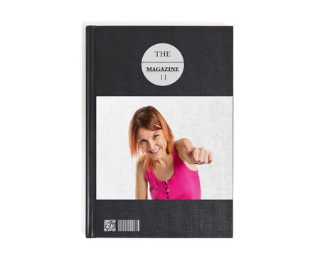 Pretty young girl with thumbs up printed on book photo