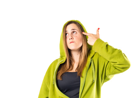 Young girl making suicide gesture over white background photo