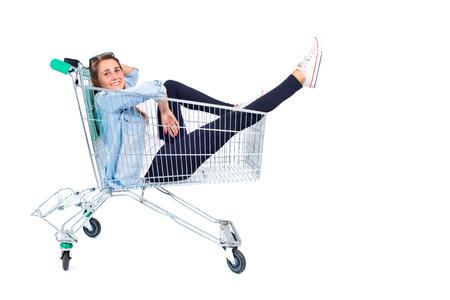 Blonde pretty girl inside supermarket cart photo