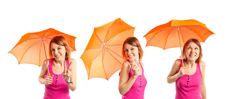 Girl holding an umbrella over white background photo