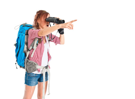 girl looking through binoculars over white background photo