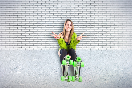 Pretty young girl wearing urban style with roller-skates photo
