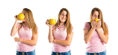 Blonde girl drinking coffee over white background photo