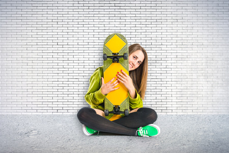Blonde girl with skate photo