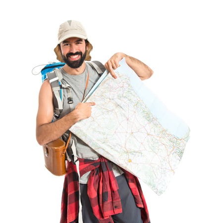 Backpacker with map over white background photo