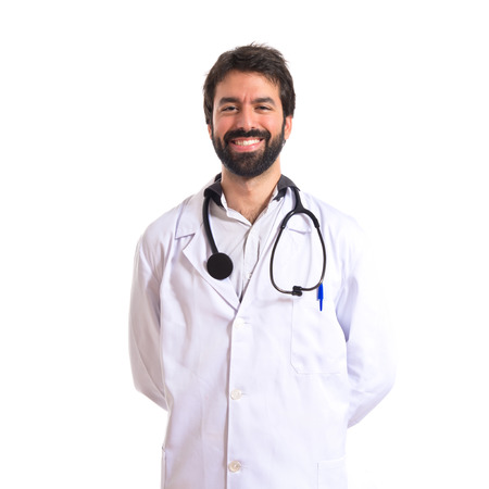 Happy doctor over white background photo