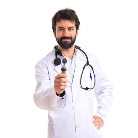 otorhinolaryngologist: Otorhinolaryngologist with his otoscope over white background