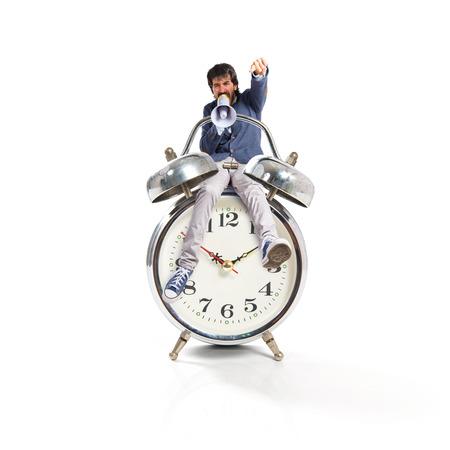 Man shouting on vintage clock photo