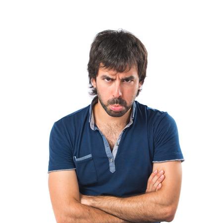Sad man over isolated white background photo