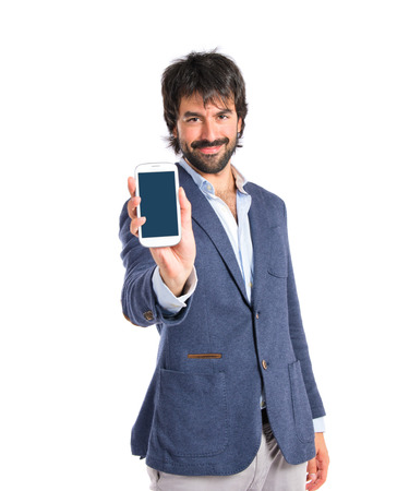 Brunetteman showing a mobile over white background photo