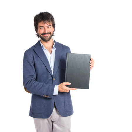 Businessman reading a book over white background photo