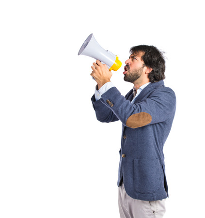 Businessman shouting over isolated white background photo