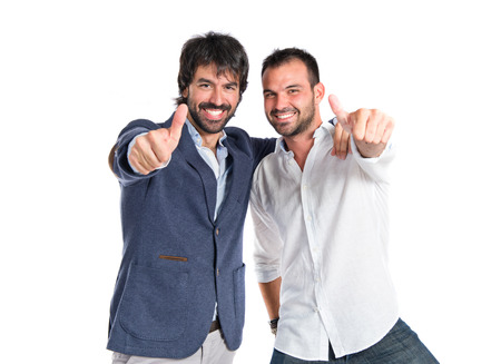 Friends with thumb up over white background photo