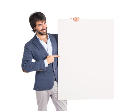 Businessman with empty placard over idolated white background photo