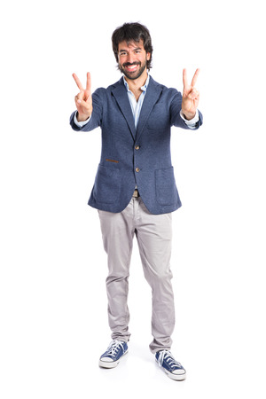 Lucky man over isolated white background photo